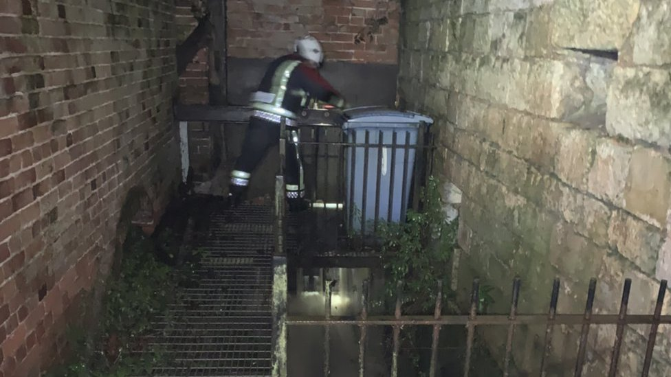 Firefighter opening sluice gate