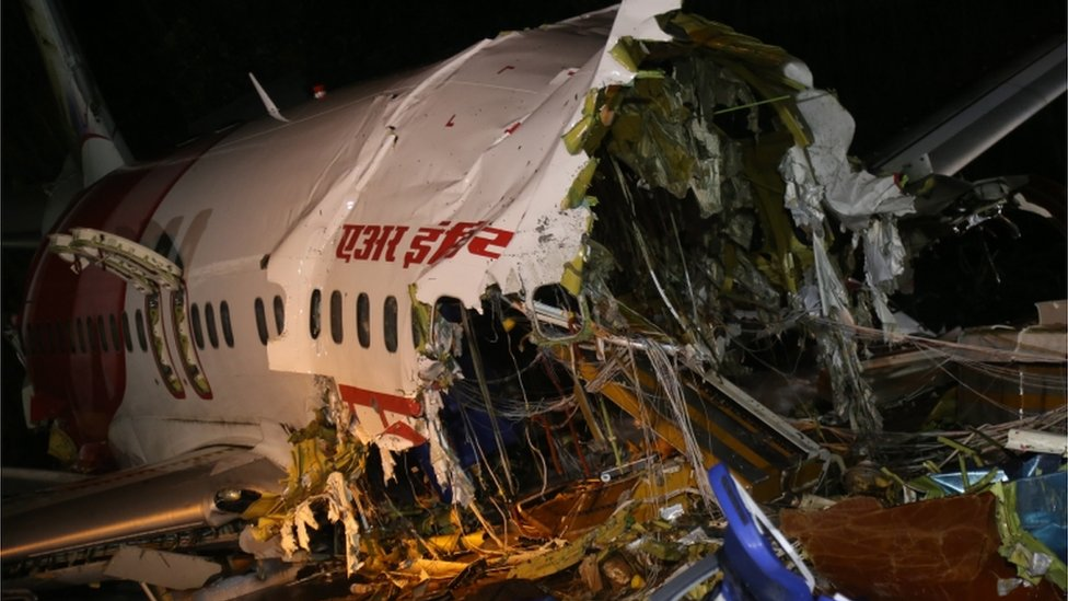 A view of the wreckage of the of an Air India Express Boeing 737 after it crashed at Calicut International Airport in Kozhikode, India, 08 August 2020. According to media reports, at least 17 people were killed after an Air India Express Boeing 737 en route from Dubai with 190 people on board skidded off the runway at Calicut International Airport during a landing amid rain and broke in two
