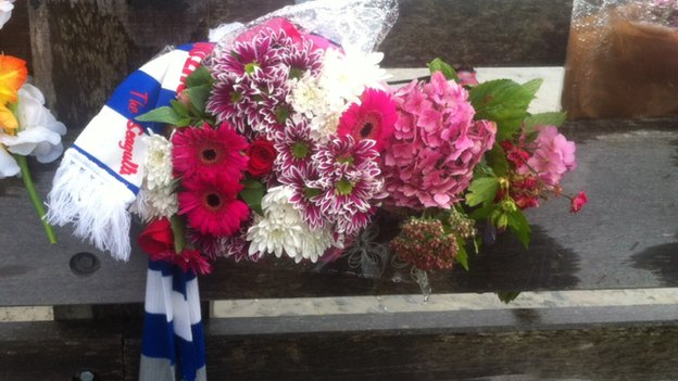 Floral tribute to Matthew Grimstone and Jacob Schilt