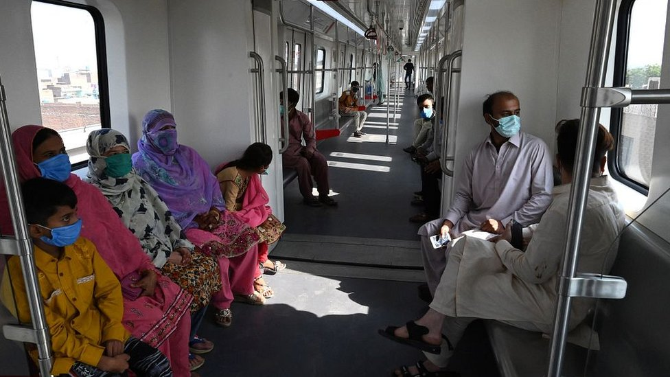 Passengers ride a train on the newly built Orange Line Metro in Lahore