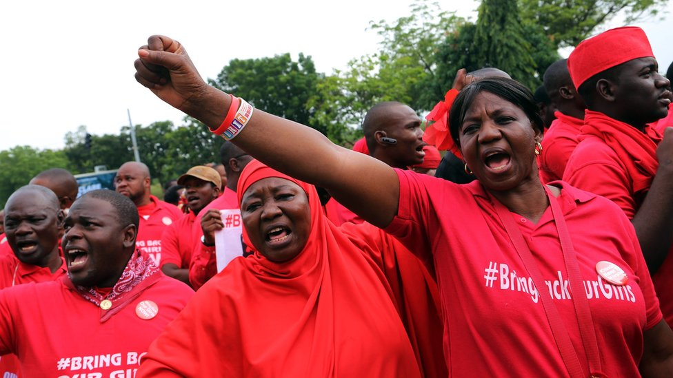 Members of Bring Back Our Girls group with fists up during a march