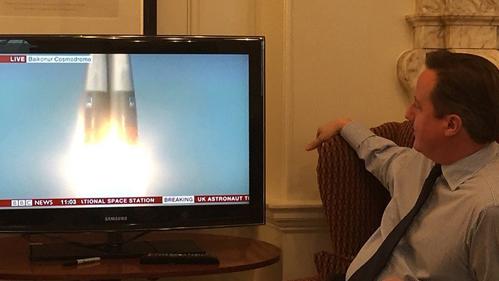 David Cameron watching a space launch on TV