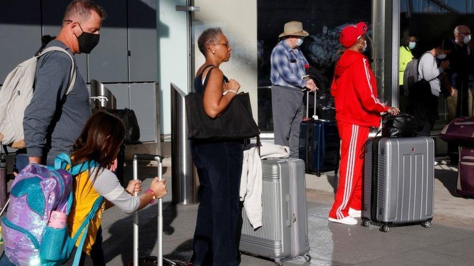 Travelers depart ahead of the Thanksgiving holiday during the coronavirus disease (COVID-19) pandemic, in Atlanta, Georgia