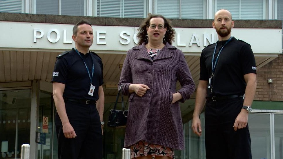 Police Scotland officers with hate crime victim Cathleen Lauder