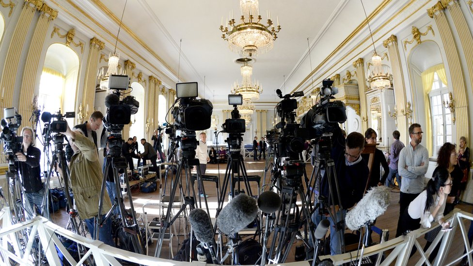 TV cameras covering a Nobel prize announcement at the Swedish Academy
