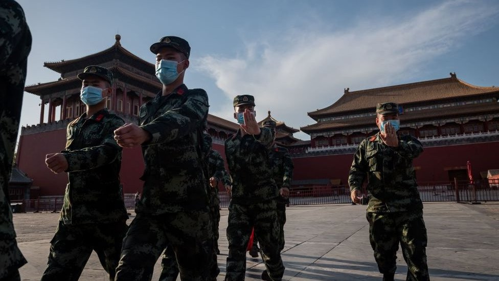 People's Liberation Army (PLA) soldiers march in the Forbidden City in Beijing on May 19, 2020.