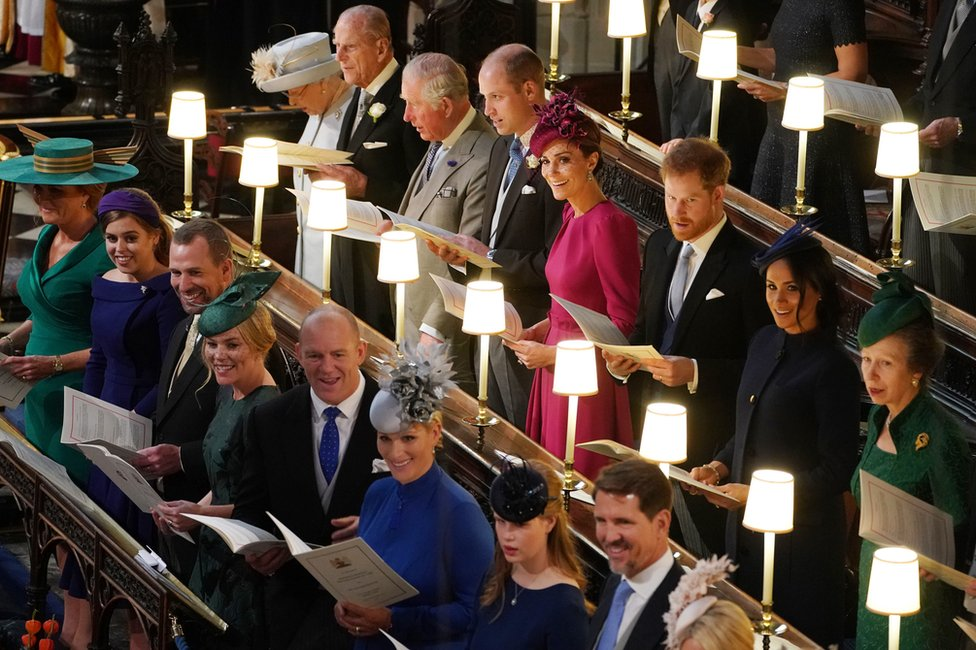 Queen Elizabeth II, the Duke of Edinburgh, the Prince of Wales, the Duke of Cambridge, the Duchess of Cambridge, the Duke of Sussex, the Duchess of Sussex and the Princess Royal, (left to right front row) Sarah Ferguson, Princess Beatrice, Peter Phillips, Autumn Phillips, Mike Tindall, Zara Tindall, Lady Louise Mountbatten-Windsor and Crown Prince Pavlos of Greece at the wedding of Princess Eugenie to Jack Brooksbank at St George's Chapel in Windsor Castle