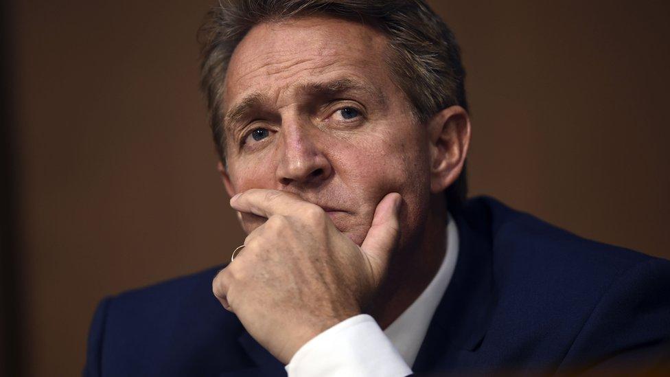 "Sen. Jeff Flake(R-AZ) listens during Brett Kavanaugh""s US Senate Judiciary Committee confirmation hearing"