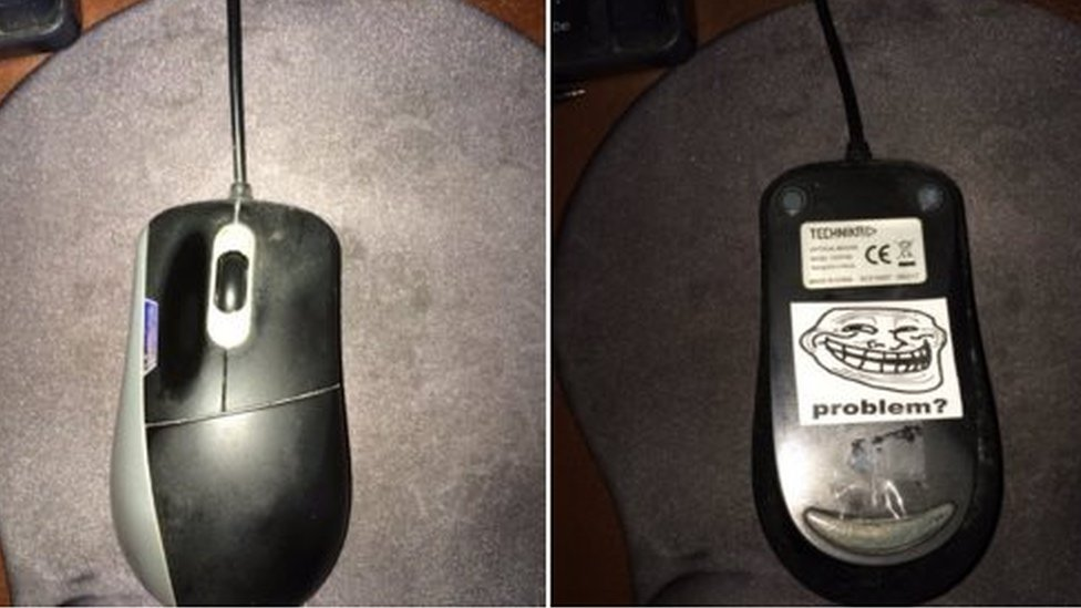 Picture of computer mouse with sticker under it