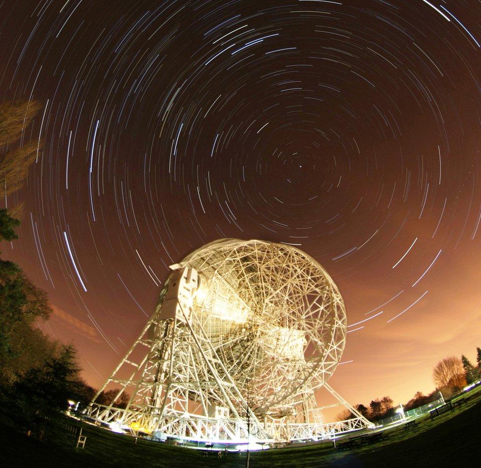timelapse still of star trails behind the Lovell Telescope