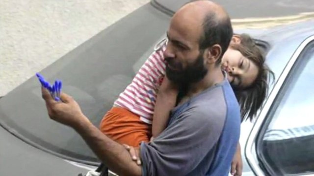 Halim with three-year-old child selling pens in Beirut