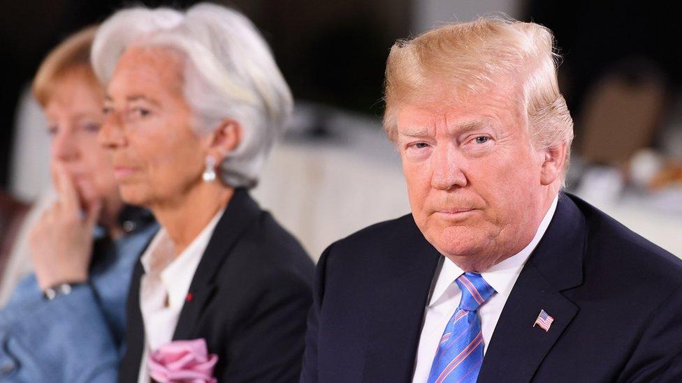المستشارة الألمانية أنجيلا ميركل، وكرستين لاجارد مديرة صندوق النقد الدولي ودونالد ترامب الرئيس الأمريكي.