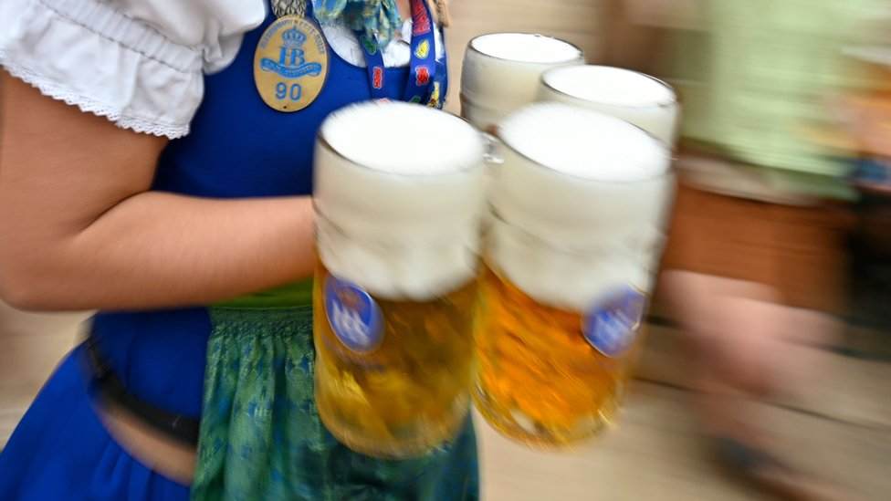 Waitress carrying beer at Oktoberfest in its opening weekend on 22 September 2019
