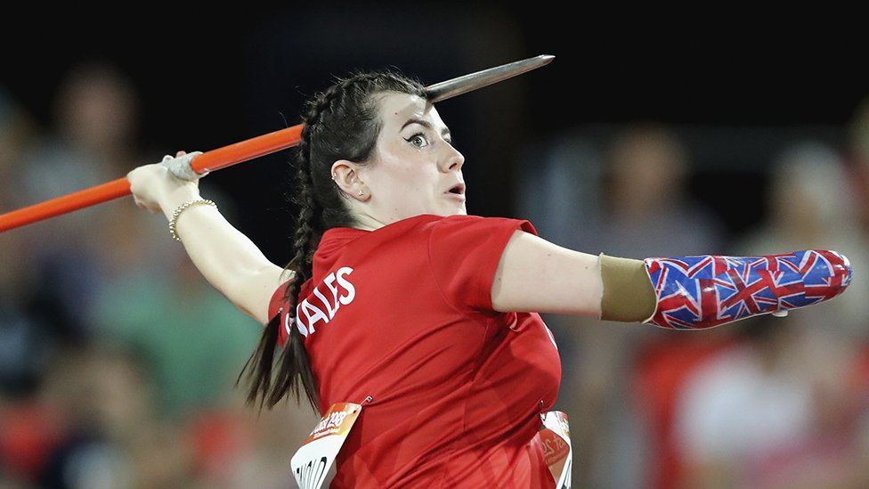 Hollie Arnold throwing a javelin