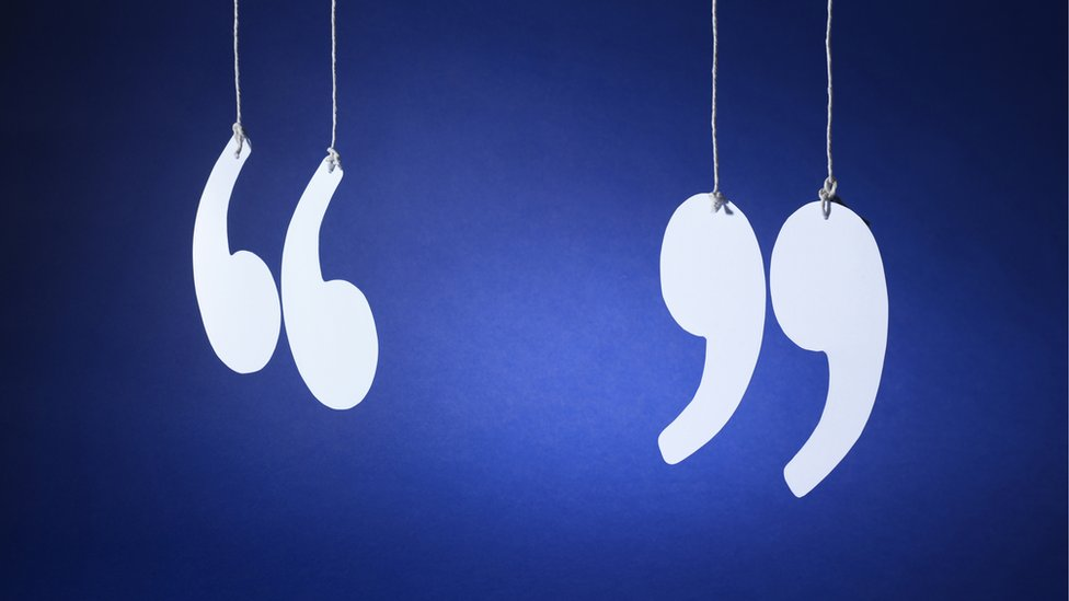 Quotation marks hanging by threads