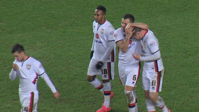 Simon Church scores a penalty for MK Dons