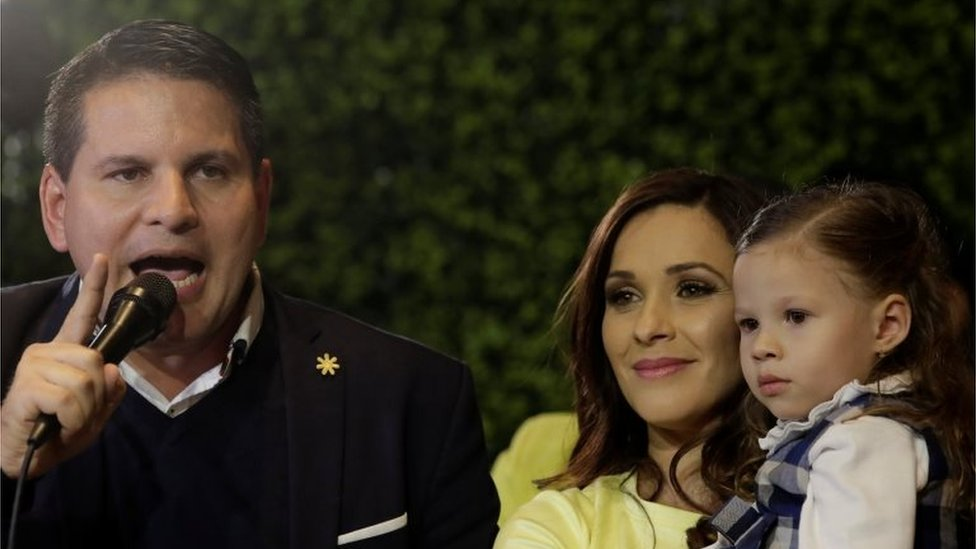 Fabricio Alvarado, presidential candidate of the National Restoration party (PRN), speaks to his supporters next to his wife Laura Moscoa and his daughter during a rally after Costa Rica's presidential election in San Jose, Costa Rica February 4, 2018.