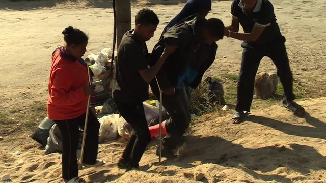 Migrants at the camp known as 'The Jungle' in Calais