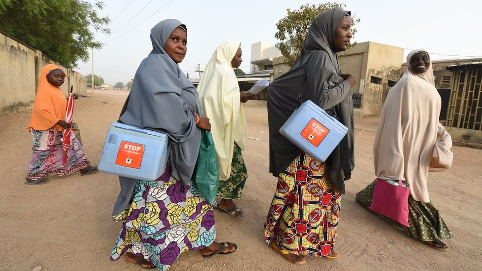 Female health workers on a drive to vaccinate children against polio in Nigeria's Kano state