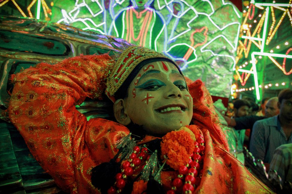 An actor grinning at last year's Ramlila.