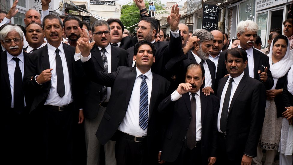 Lawyers chant slogans condemning the bombing