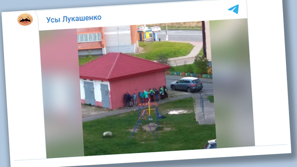 Telegram video showing Belarusian children standing behind an electrical substation, facing a wall and holding their hands behind their backs