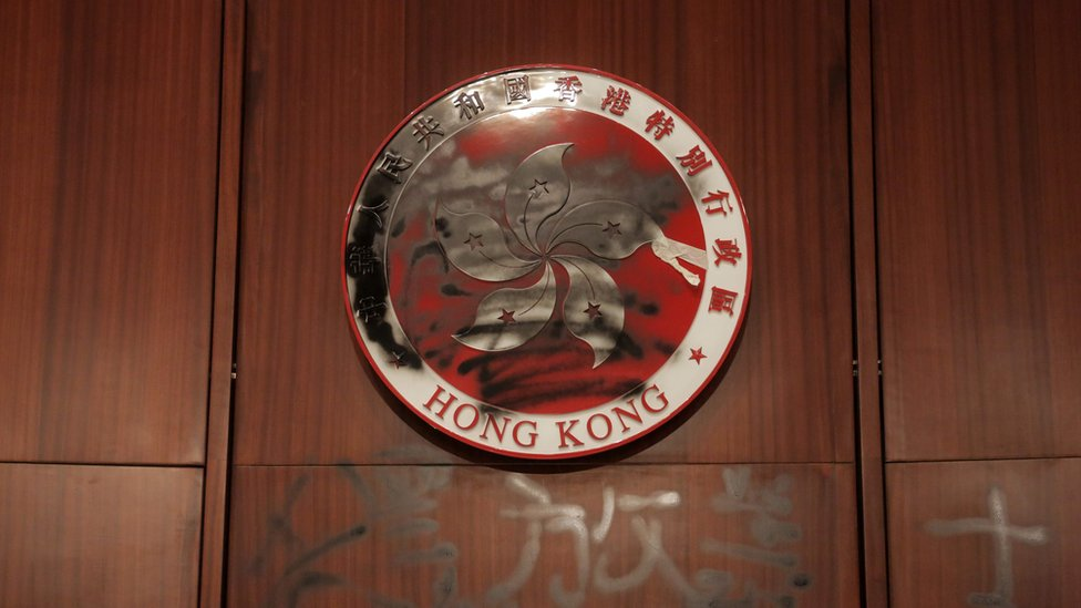 The Hong Kong emblem is spray painted