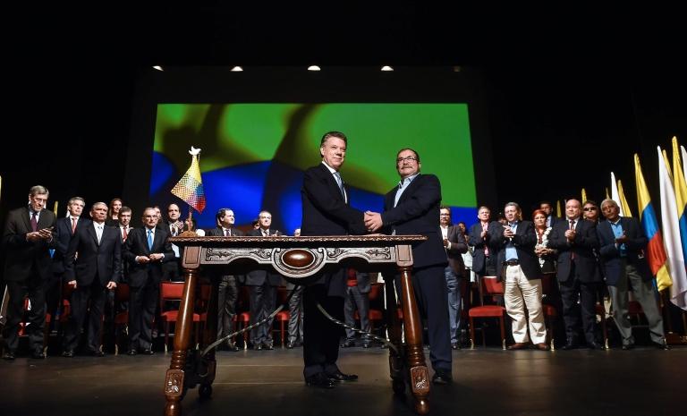 Presidente de Colombia Juan Manuel Santos y el líder de las FARC, Timochenko