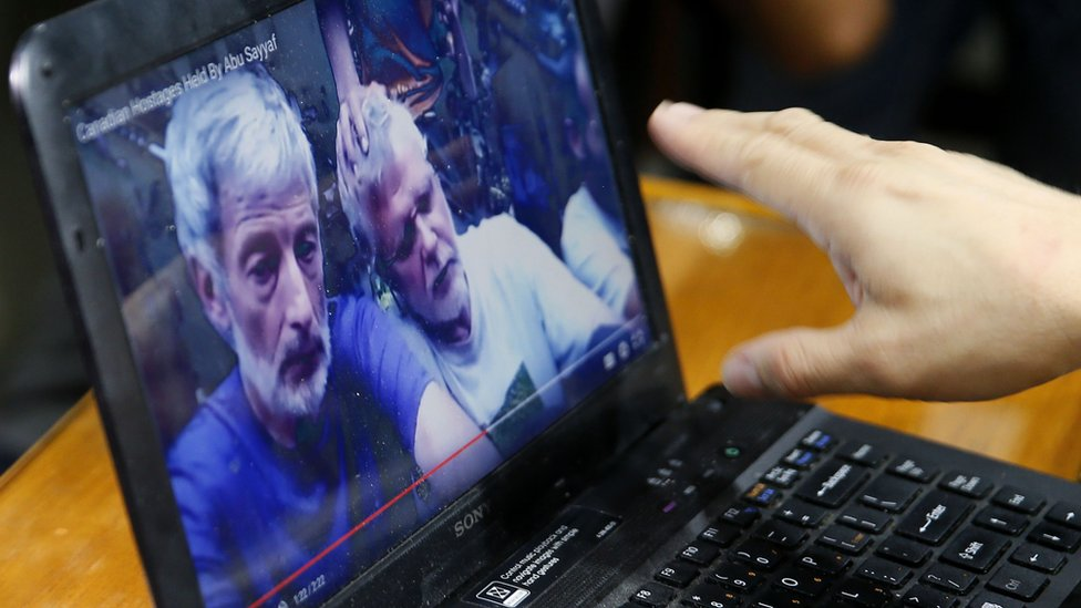 A laptop shows a video allegedly showing hostages of the Abu Sayyaf militant group in the Philippines