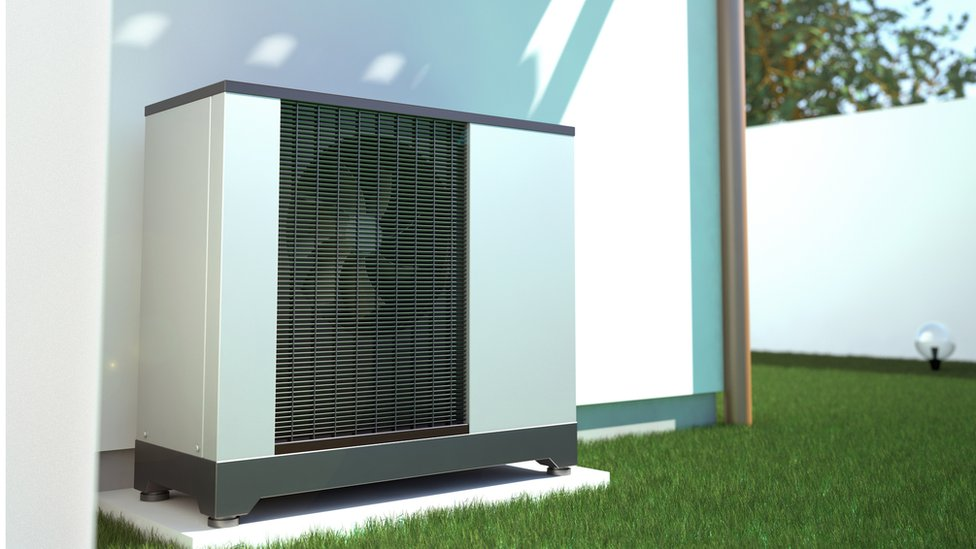 3d image of air source heat pump on the side of a house