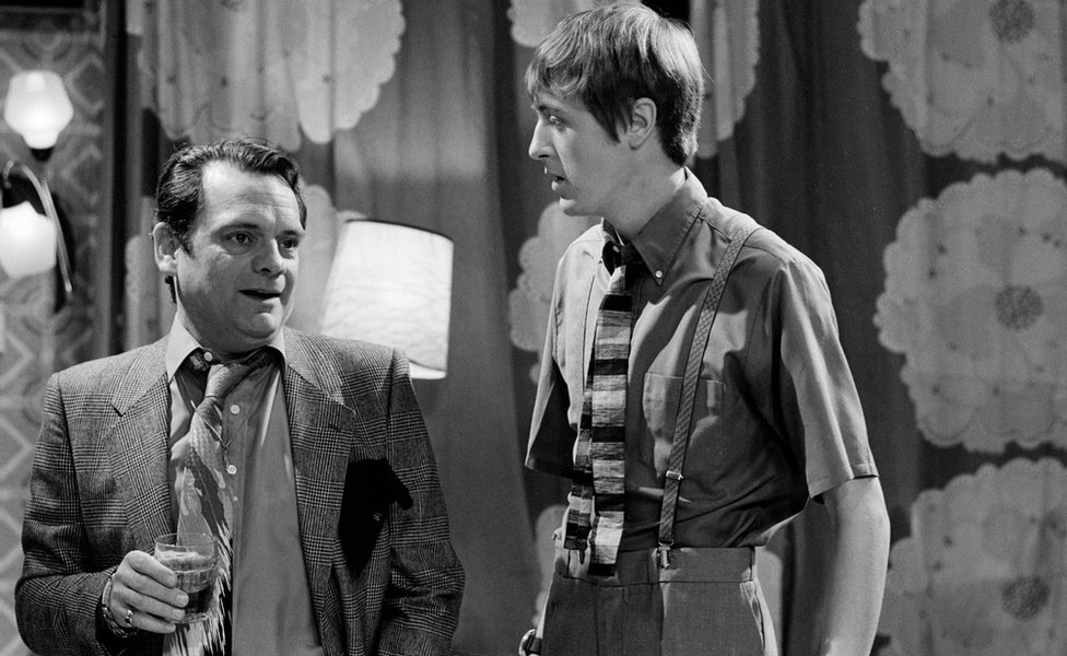 Black and white image of David Jason and Nicholas Lyndhurst standing side by side during filming