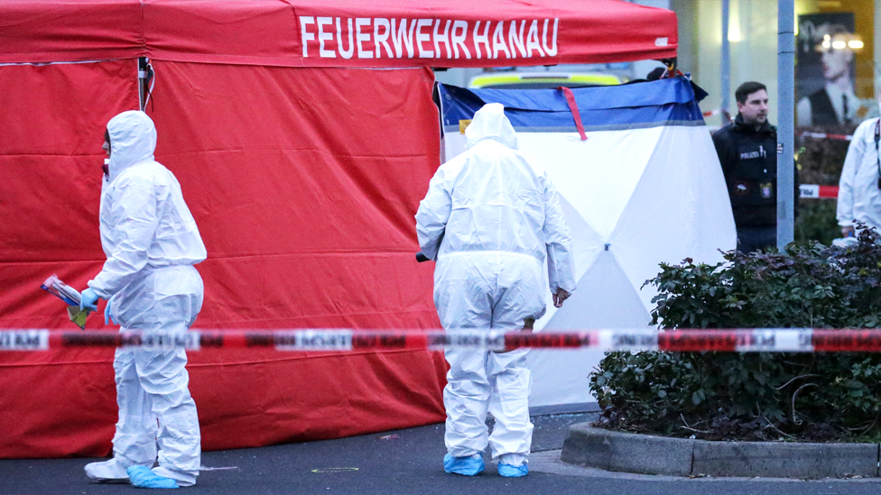 Forsenic Police work near at the crime scene after two shootings in Hanau