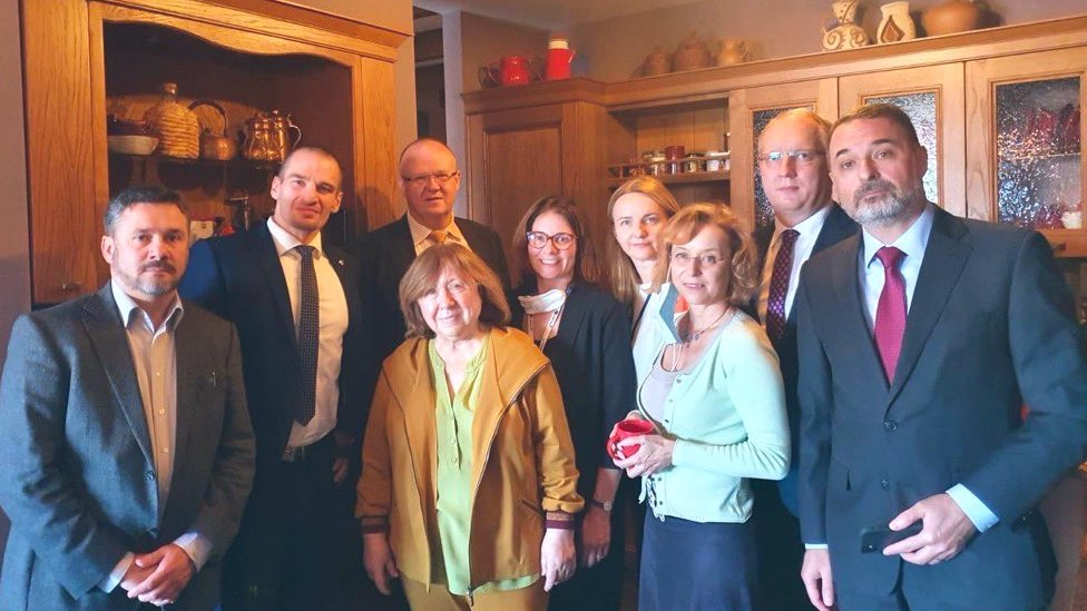 Svetlana Alexievich (centre) surrounded by diplomats at her home in Minsk, Belarus. Photo: September 2020
