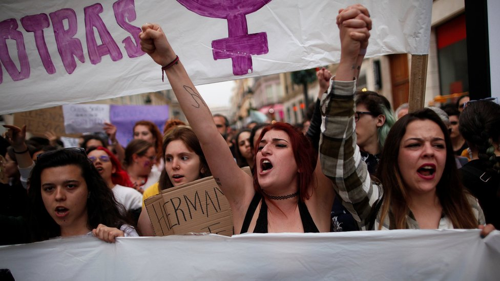 People shout slogans during a protest after a Spanish court condemned five men accused of the group rape of an 18-year-old woman, in Malaga