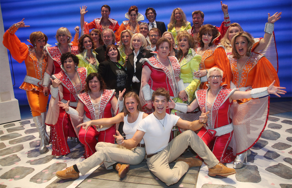 Theatre producer Judy Craymer (centre) is flanked by Benny Andersson (centre left) and Bjorn Ulvaeus (centre right), along with the cast and crew - including 12 former Dynamos - during the finale of the musical Mamma Mia!