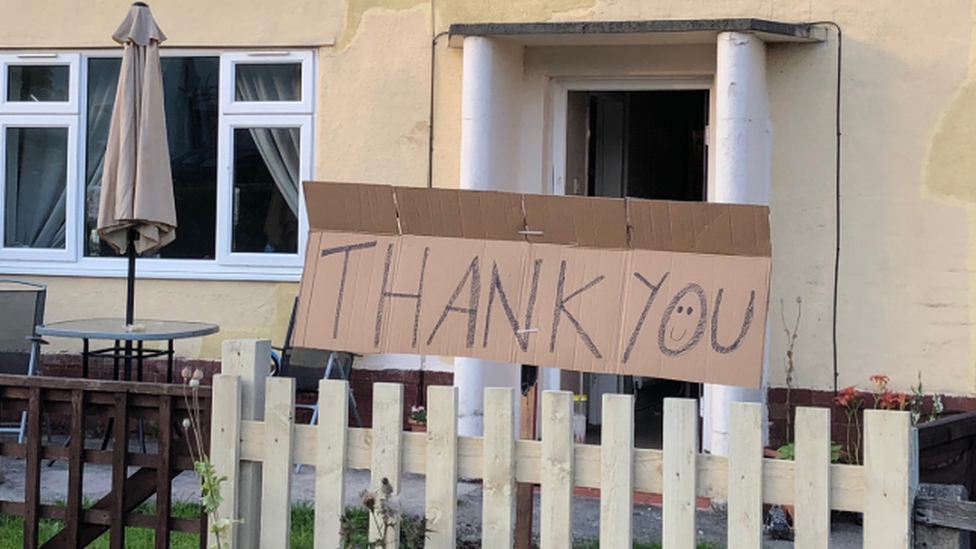 A thank you sign in front of a house