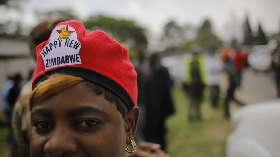 People wait for the rumoured arrival of Zimbabwean former vice president Emmerson Mnangagwa, at an air force base in Harare, Zimbabwe, 22 November 2017