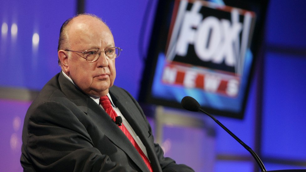 Roger Ailes with a Fox News sign