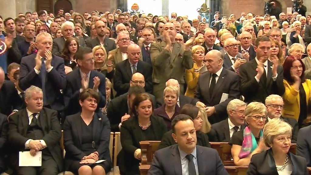 Lyra McKee: Standing ovation as priest challenges politicians