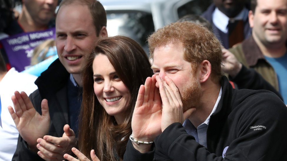 Prince William, Catherine, Duchess of Cambridge, and Prince Harry cheering