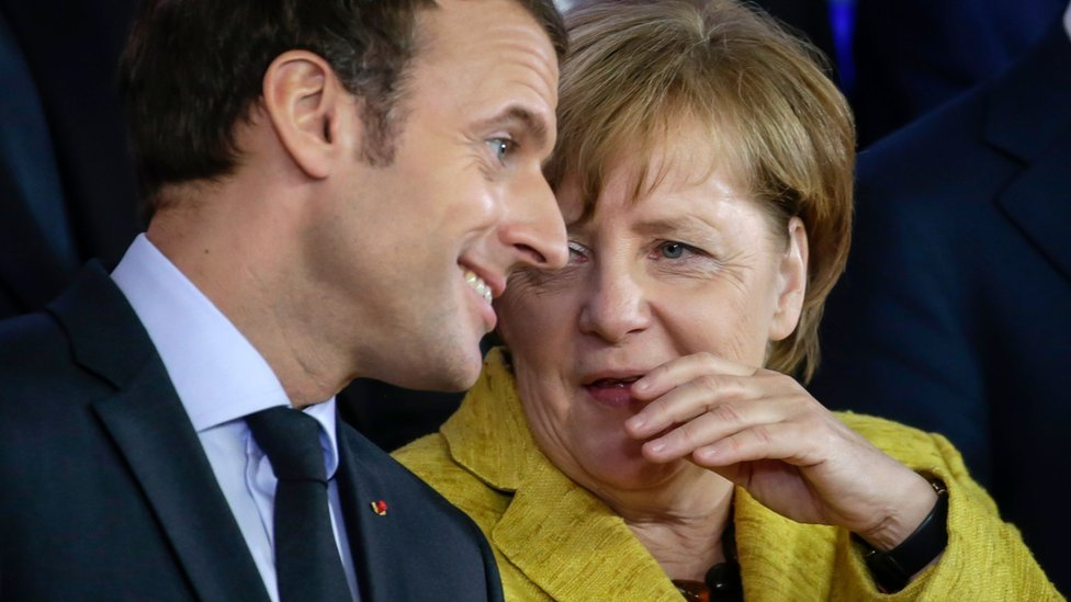 Emmanuel Macron and Angela Merkel speak at the EU summit in November 2017