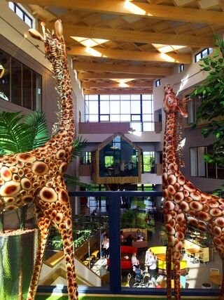 Models of giraffes at Moneypenny office
