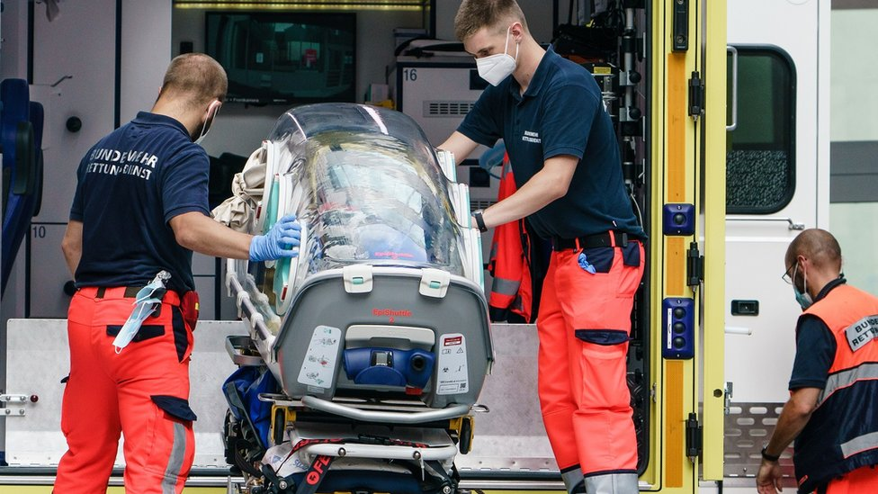 German army emergency personnel load portable isolation unit (Epi Shuttle) into their ambulance that was used to transport Russian opposition figure Alexei Navalny at Charite hospital on August 22, 2020 in Berlin, Germany