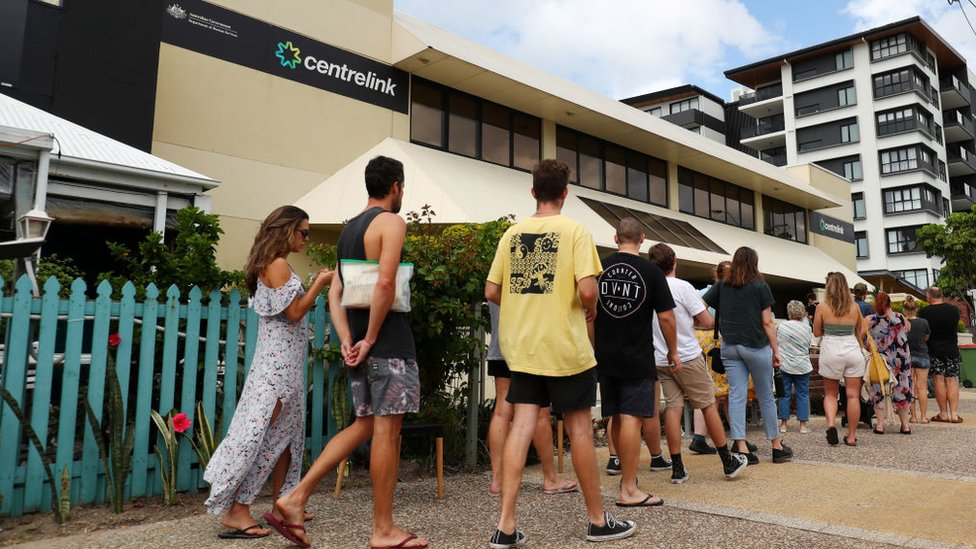 People queue to enter a Centrelink welfare office in Queensland in May