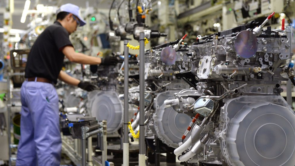 An employee of Toyota Motor's subsidiary Toyota Motor Kyushu assembles a new 2-litre gasoline turbo engine