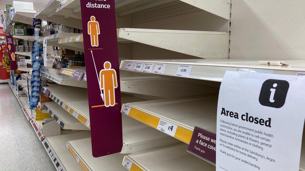 Empty shelves in a supermarket in Tenby