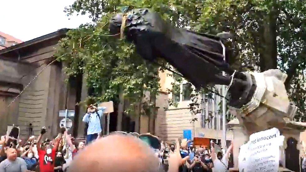 Protesters tear down Edward Colston statue in Bristol