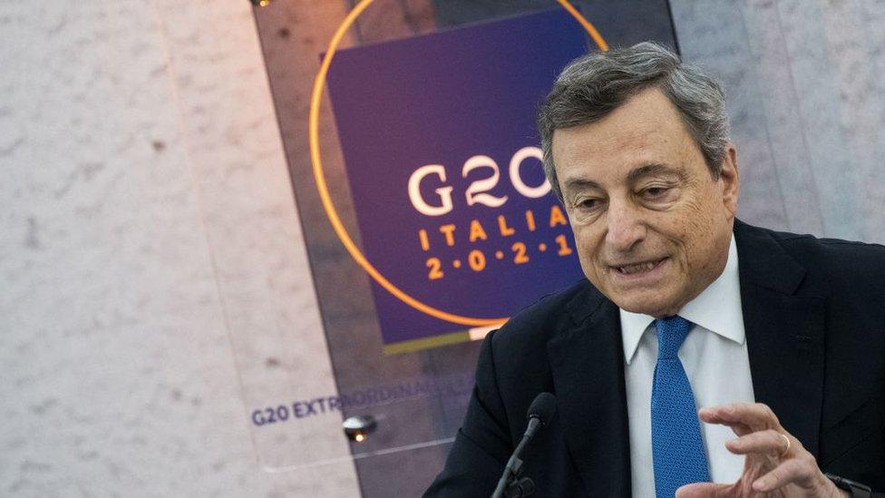 رئيس الوزراء الإيطالي ماريو دراغي أثناء مؤتمر صحفي عقب قمة افتراضية لمجموعة العشرين، في 12 أكتوبر/تشرين أول 2021