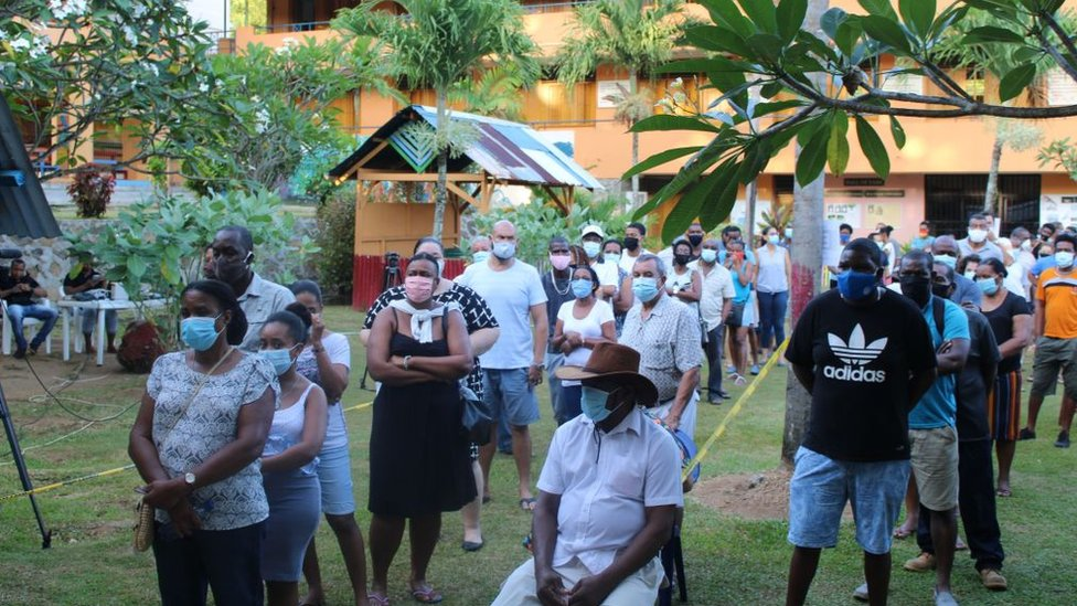 Voters queue at the Beau Vallo polling station, Mahe Island, on October 24, 2020 during the presidential and legislative elections