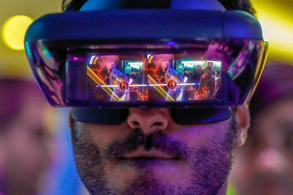 Man wearing Lenovo AR glasses